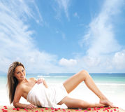 Young woman getting spa treatment on the beach Stock Image