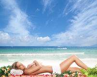 Young woman getting spa treatment on the beach Stock Photography