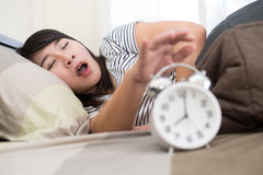 Young woman getting stressed about waking up too early, shallow Stock Photo