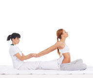 A young woman getting a traditional Thai massage Stock Photography