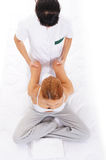 A young woman getting a traditional Thai massage Royalty Free Stock Images