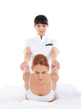 A young woman getting a traditional Thai massage Royalty Free Stock Image