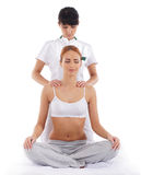 A young woman getting a traditional Thai massage Stock Photos