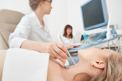 Young woman getting ultrasound scanning examination at the hospi stock image