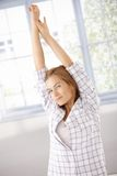 Young woman getting up stretching in the morning Royalty Free Stock Photography
