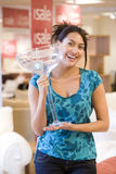 Young woman with giant cocktail glass in shop, smiling, portrait Royalty Free Stock Photography
