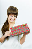 Young woman with a gift Royalty Free Stock Image