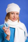 Young  woman with a gift. Young merry woman with a gift in hands on a blue background Royalty Free Stock Photos