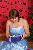Young  woman with a gift Royalty Free Stock Images