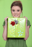 Young woman with gift Stock Images