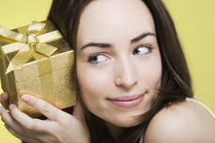 Young woman with gift box Stock Images