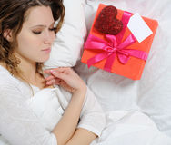 Young woman with a gift box Royalty Free Stock Images