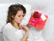 Young woman with a gift box Royalty Free Stock Photos