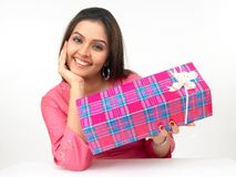Young woman with a gift box Royalty Free Stock Photography