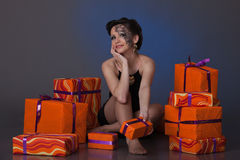 Young woman with gift boxes. Stock Photo