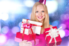 Young woman with gift boxes Royalty Free Stock Photo