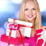Young woman with gift boxes Stock Photography