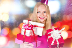Young woman with gift boxes Stock Photo