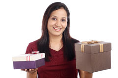 Young woman with gift boxes Royalty Free Stock Images