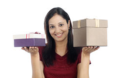 Young woman with gift boxes Royalty Free Stock Photos