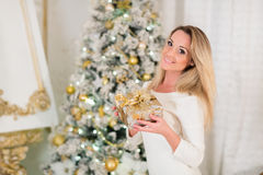 Young  woman with gift. Christmas. Stock Photo