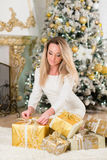 Young  woman with gift. Christmas. Stock Photos