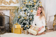 Young  woman with gift. Christmas. Royalty Free Stock Photography