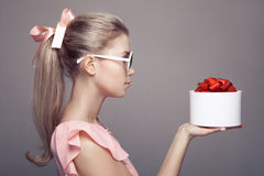 Young woman with a gift in hand. Royalty Free Stock Photo
