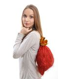 Young woman with gift sack. Isolated on white Stock Image
