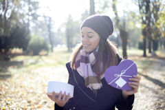 Young woman with a gift in their hands Royalty Free Stock Photo