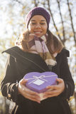 Young woman with a gift in their hands Stock Images