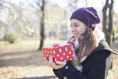 Young woman with a gift in their hands Stock Photo