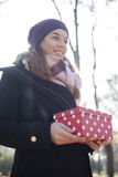 Young woman with a gift in their hands Stock Image