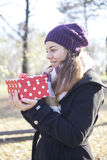 Young woman with a gift in their hands Stock Photos
