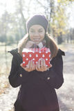 Young woman with a gift in their hands Royalty Free Stock Photos