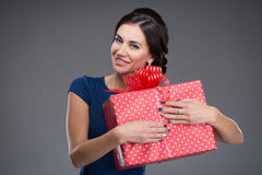 Young woman with a gift in their hands Stock Photography