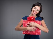 Young woman with a gift in their hands Royalty Free Stock Image