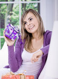 Young woman with gifts Royalty Free Stock Image