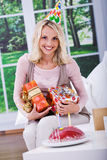Young woman with gifts Stock Images