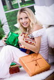 Young woman with gifts Stock Photos