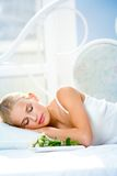Young woman with gifts on bed Royalty Free Stock Images