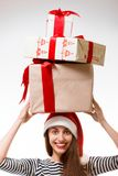 Young woman with gifts on Christmas Stock Photos