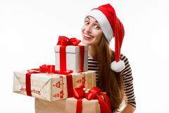 Young woman with gifts on Christmas Royalty Free Stock Image
