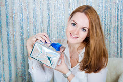 Young woman with gifts near a Christmas tree Stock Photos