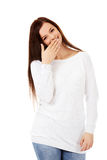 Young woman giggles covering her mouth with hand Stock Photography