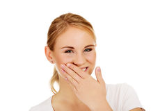 Young woman giggles covering her mouth with hand Royalty Free Stock Photos