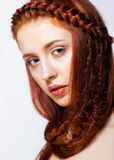 Young  woman with ginger braids hairdo on white background. Young ginger woman with red braids hairdo on white background Royalty Free Stock Photography
