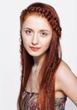 Young  woman with ginger braids hairdo on white background Royalty Free Stock Photography