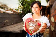 Young Woman With Gingerbread Heart Royalty Free Stock Photos