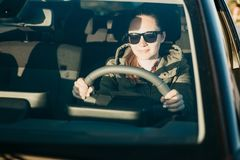 Young woman or girl driver inside the car. Stock Images